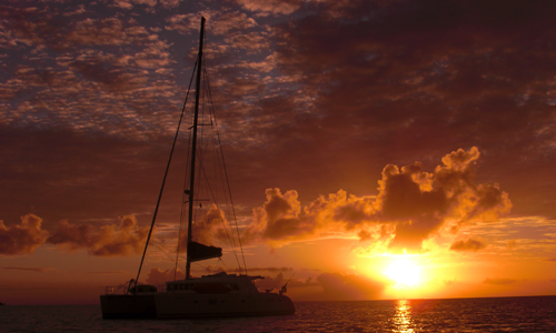 belize-luxury-sailing-vacation-boats-journeys-sunset