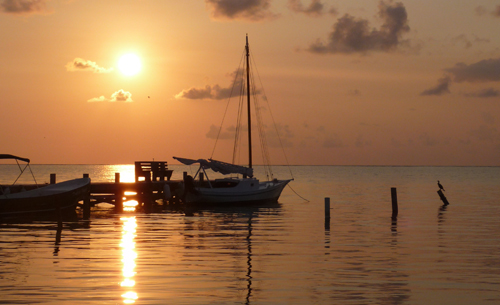 Cayes-Resort-Sundiver-boat-sunset